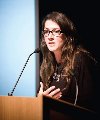 Jacqui speaking at a conference
